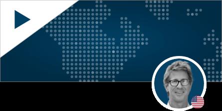 John Bowe Headshot on World Map Background