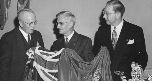 Smedley and two men with flag