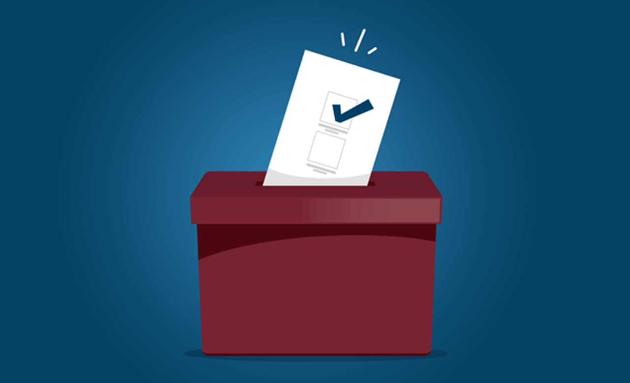 A voting ballot being placed into a ballot box