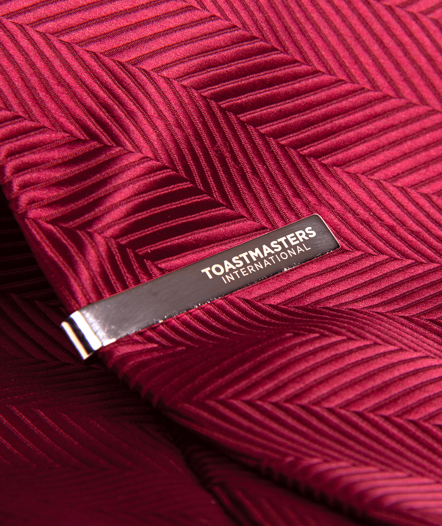 Close up of Tie Bar on burgundy tie