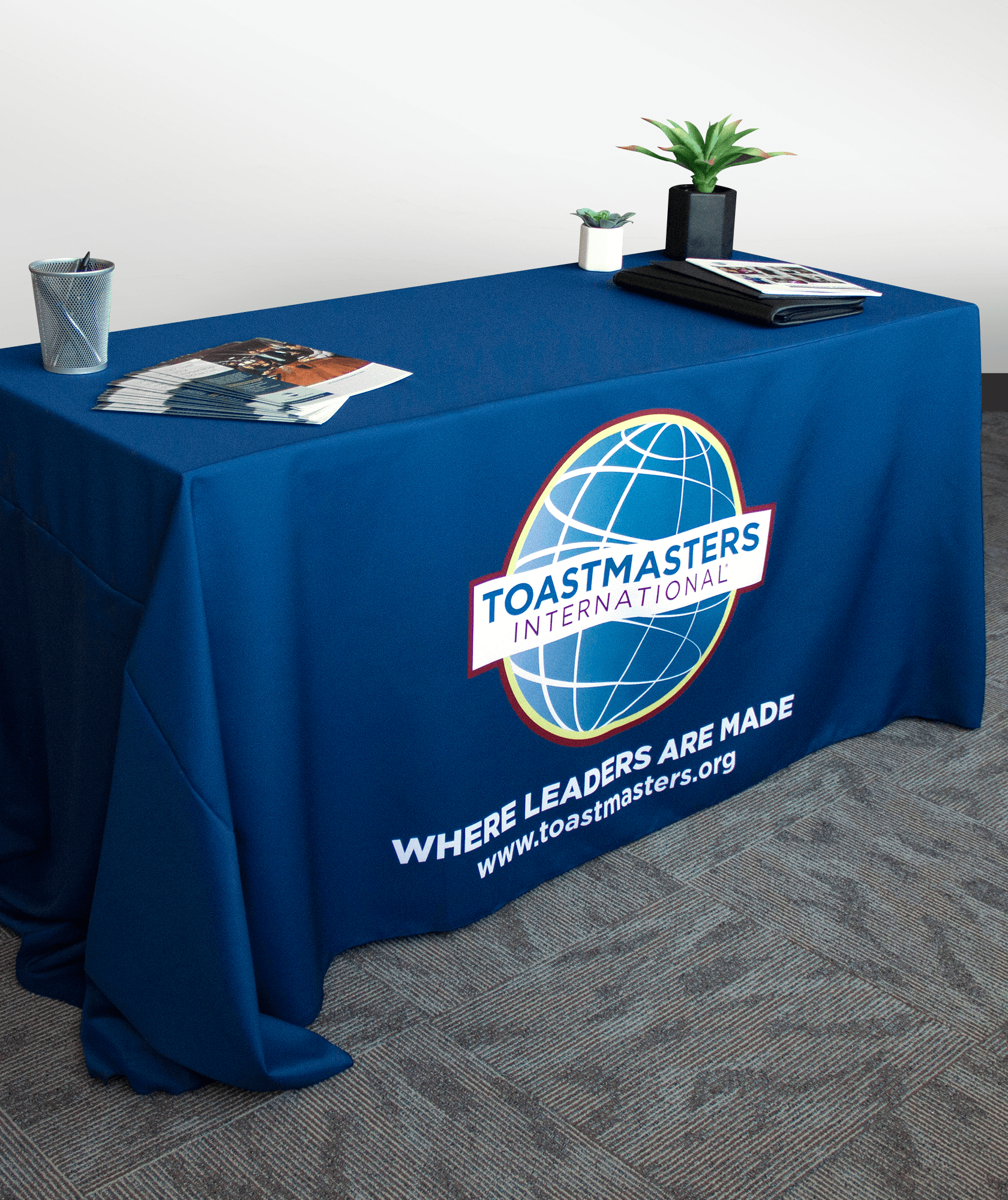 Navy tablecloth with color logo, tagline and website