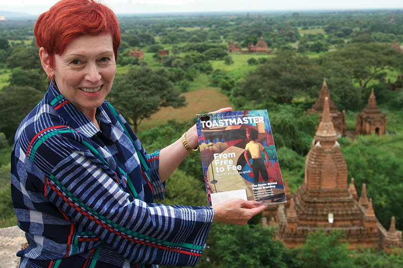 Nancy Norton, ACG, CL, from Paris, France, stands on top of a historic temple overlooking the southeastern plains of Bagan, Myanmar.
