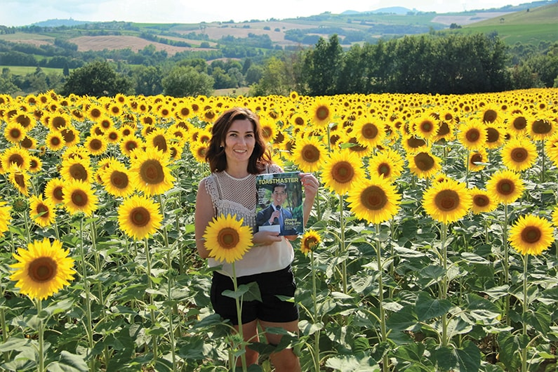 Anna Trach, from Kyiv, Ukraine, poses in a sunflower field in Italy.