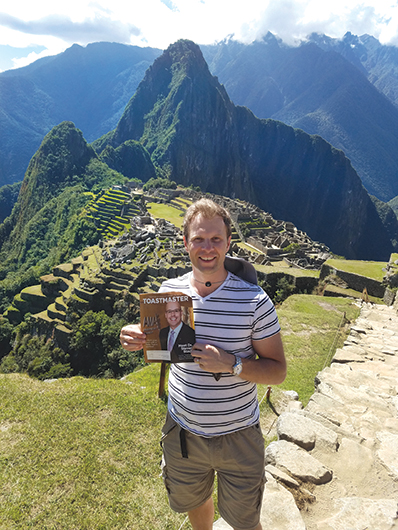 Victor Gichun, CC, from San Jose, California, stands before the Incan citadel at Machu Picchu, Peru.