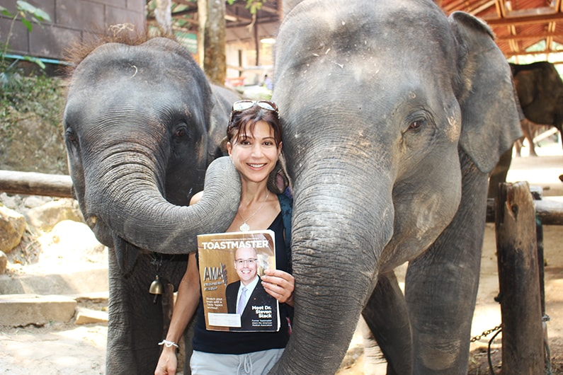 Elizabeth Borelli, from Los Gatos, California, gets cozy with the elephants in Chiang Mai, Thailand.