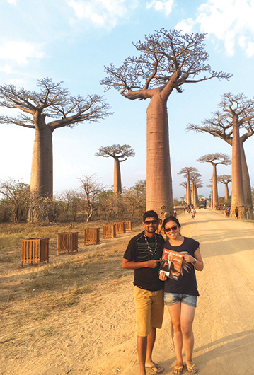Yingqi Shen, CC, (right) from China, and Suramowli Bandreddi, from India, visit the Avenue of the Baobabs in Madagascar.