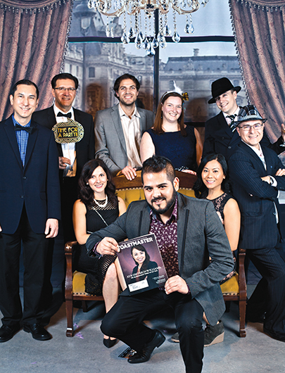 Moneris Toastmasters dress in the style of the Roaring Twenties at their holiday party in Liberty Grand entertainment complex, Toronto, Canada.
