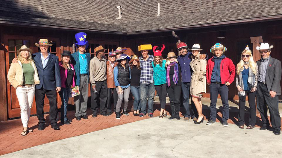 The North Coast Toastmasters club in Encinitas, California, celebrates new members while wearing fun hats.