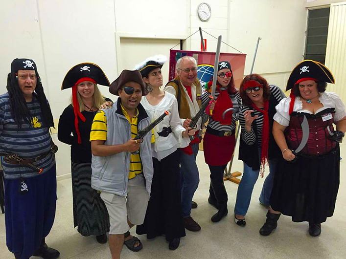 Members of the Pines Toastmasters club in Queensland, Australia, dress for a pirate-themed meeting.