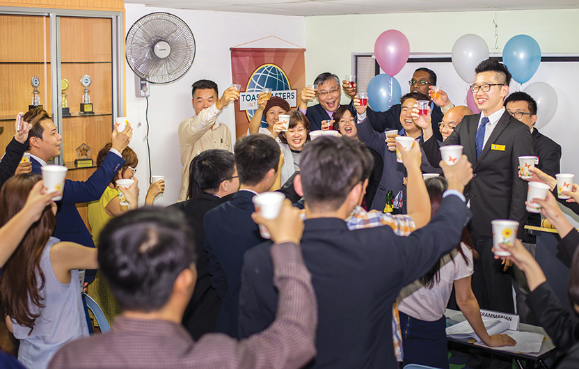 Members of Puchong English Toastmasters, in Selangor, Malaysia, toast to their 100th club meeting.