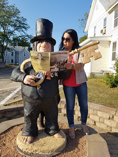 "Jean Rossett, from Franksville, Wisconsin, poses with a Mount Horeb Troll, in Mount Horeb, Wisconsin, the ""troll capital of the world."""