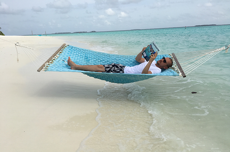 Maruf Yusupov, CC, CL, from Aarhus, Denmark, relaxes on Iru Fushi island in the Maldives.