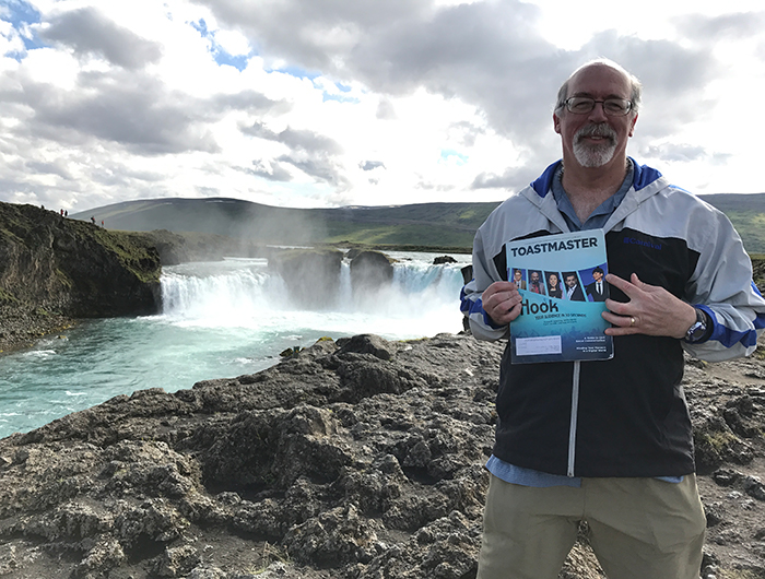 Ron Maroko, DTM, PDG, from Redondo Beach, California, enjoys the view at Godafoss Waterfall in Iceland.