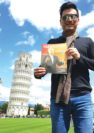 Glenn Lim, DTM, from Singapore, takes in the sights near the Tower of Pisa in Italy.