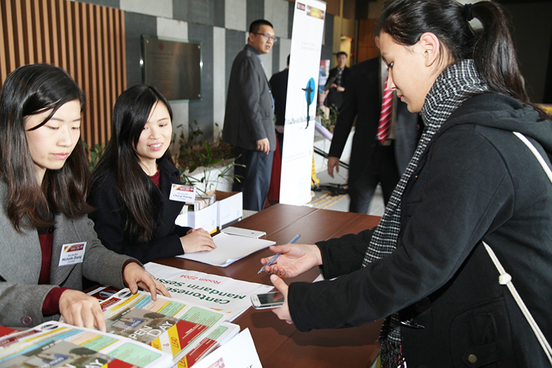 """A guest signs in for the """"Open Day"""" event put on by members of District 89 in Hong Kong."""