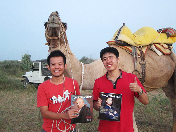 Beng Tack Cheah, CC (left) and Yen Shen Chan (right), from Malaysia, pose with their camel travel companion during their trip around the Osian Sand Dunes near Rajasthan, India.