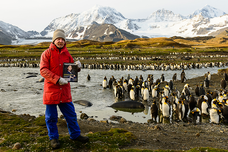 Keith Barnett, ACS, ALB, from Queensland, Australia, enjoys seeing penguins and seals at St. Andrews Bay in South Georgia, Antarctica.