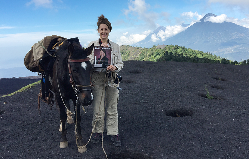 Kim Nagy, from Brighton, Massachusetts, takes a break with her horse on the way to Pacaya, an active volcano in Guatemala.