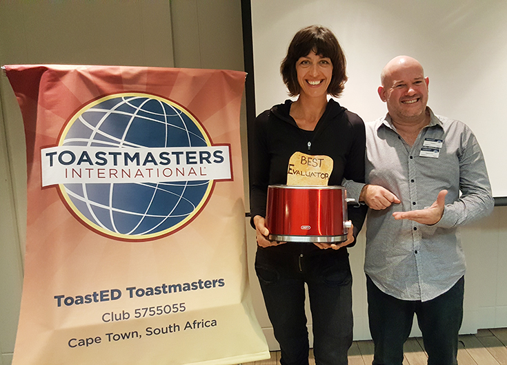 ToastED club members pose with a toaster reward for Best Evaluator.