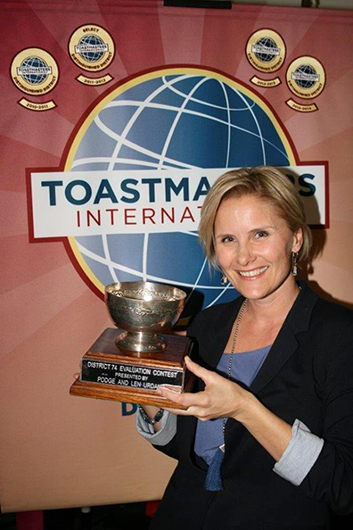 Verity Price, ACB, holds her trophy after winning first place in the District 74 Evaluation Contest. Price is the sponsor and mentor of the ToastTED club in Cape Town, South Africa.