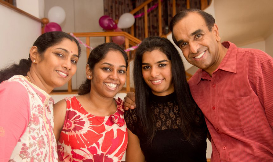 From left to right: Saru, Avisha, Mahishaa and Balraj Arunasalam pose as a family at a party.  (Photo credit: Dylan Seedin Photography)