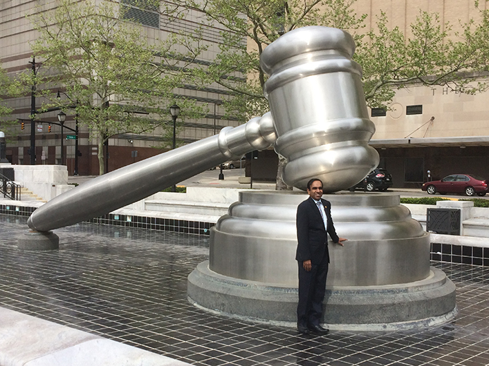 Arunasalam poses in front of the World's Largest Gavel in Columbus, Ohio.