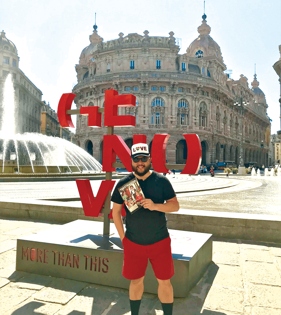 Aaron Kim, of Long Island, New York, U.S., enjoys the colorful art and ancient architecture in Genoa, Italy.