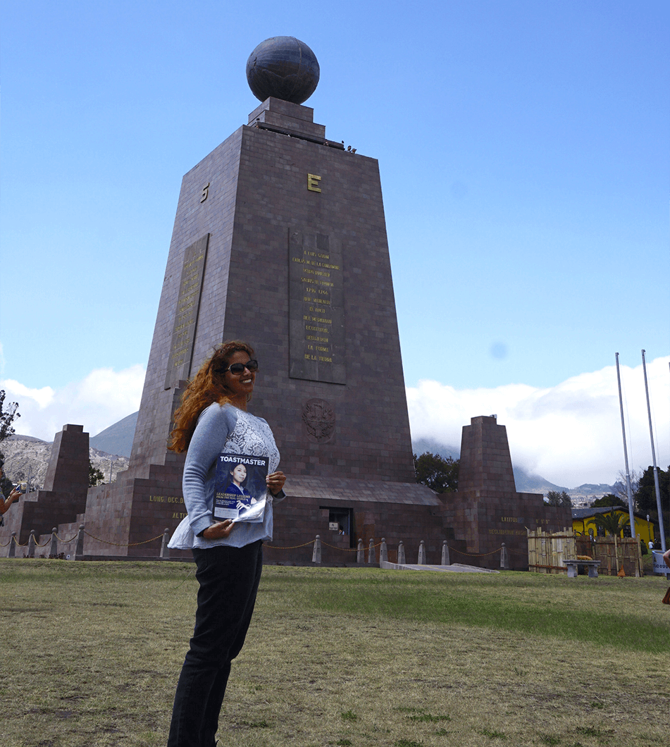 "Fay al-Najadah, ACB, CL, of Kuwait City, Kuwait, stands by the towering ""Monument to the Equator,"" in Pichincha, Ecuador, Central America."