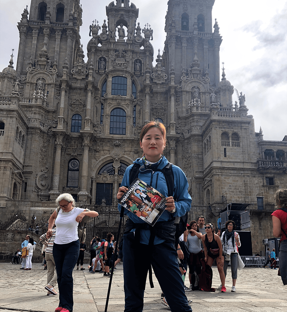 Huihui Chen, CC, from Shenzhen, Guangdong, China, stops in Santiago de Compostela, Galicia, Spain, after hiking the Camino de Santiago pilgrimage route for 16 days.