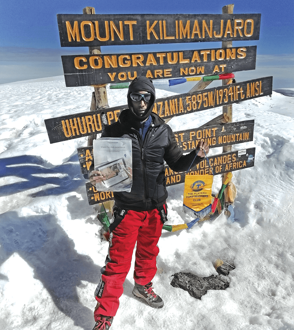 Nadarajen MooroogaN, of Quatre Bornes, Mauritius, celebrates reaching the 5,895-meter/19,341-foot summit of Uhuru Peak, Mount Kilimanjaro, Tanzania.