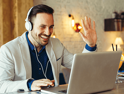 Man on a laptop at a digital team meeting