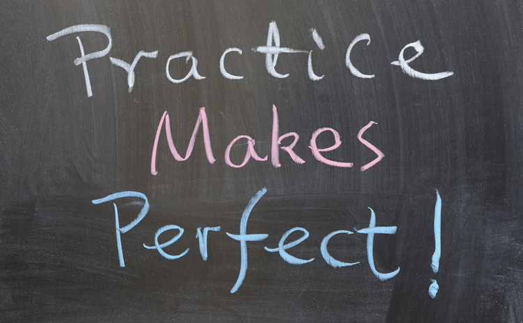 A chalkboard saying Practice Makes Perfect