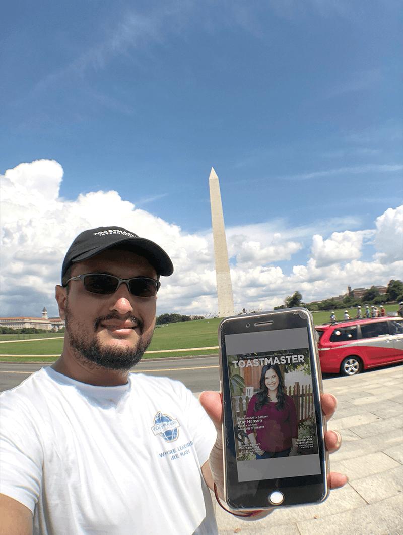 Samer Kamal, DTM, of Riyadh, Saudi Arabia, brings the online Toastmaster magazine to the Washington Memorial in Washington, D.C.