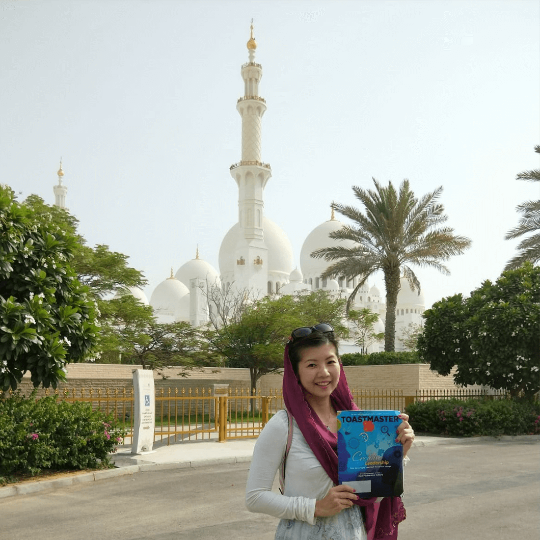 Xinni Chen, CC, CL, of Singapore, in front of the Grand Mosque, one of the largest mosques in the United Arab Emirates, in the capital city of Abu Dhabi.