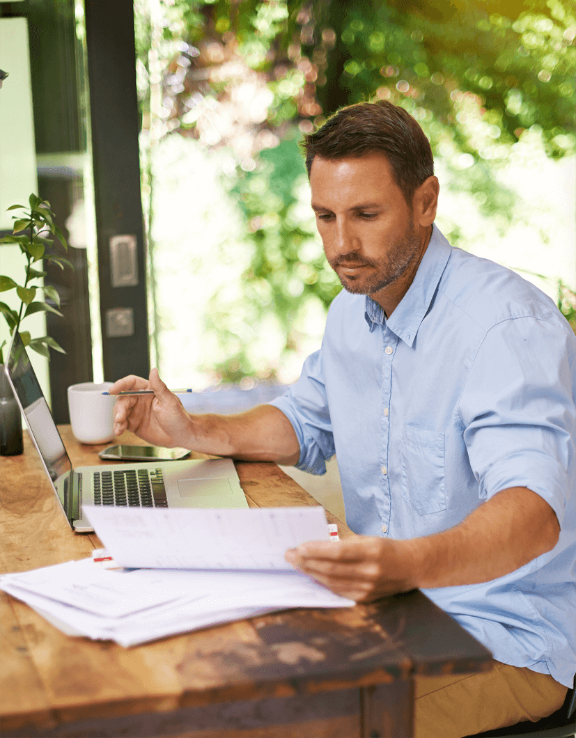 Man sitting at a table planning