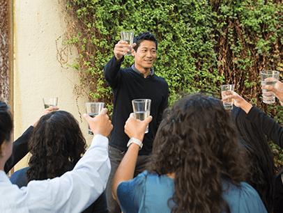 Man toasting a crowd