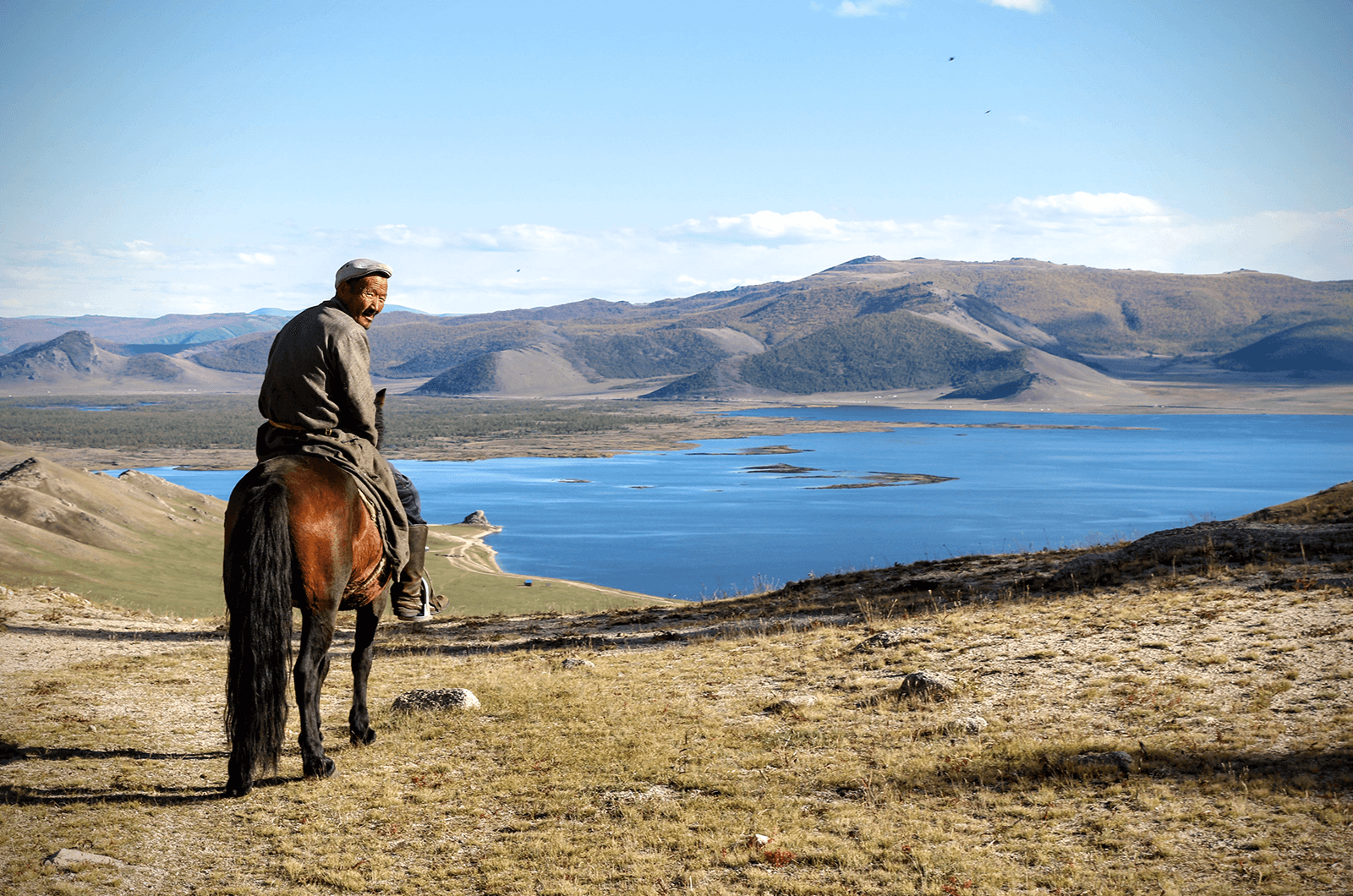 A local guide on a horse in Mongolia. Photo by Indy Guide.