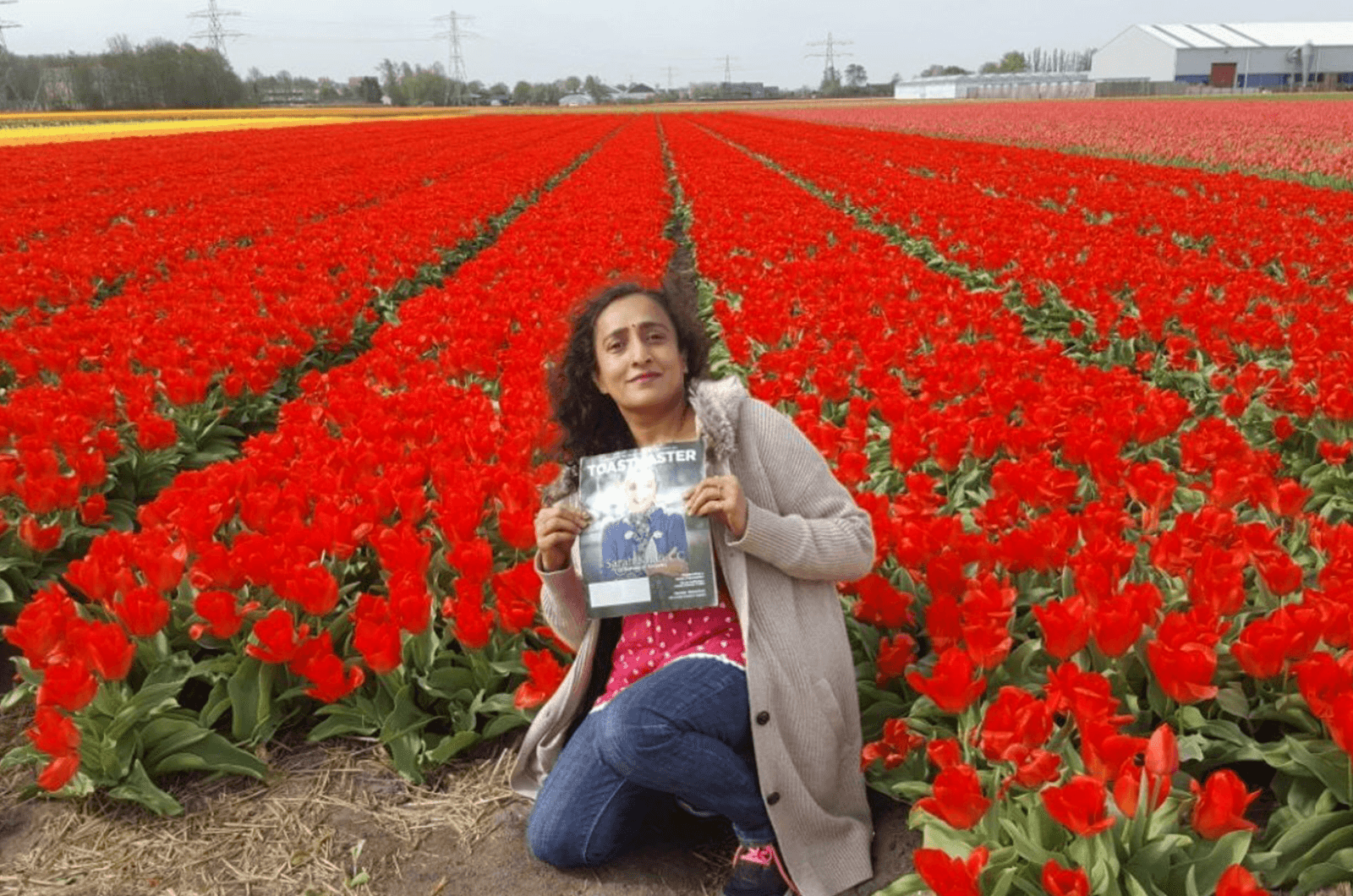 Gomathy Ram, CC, ALB, of Dubai, United Arab Emirates, relaxes in a tulip field in the Netherlands.