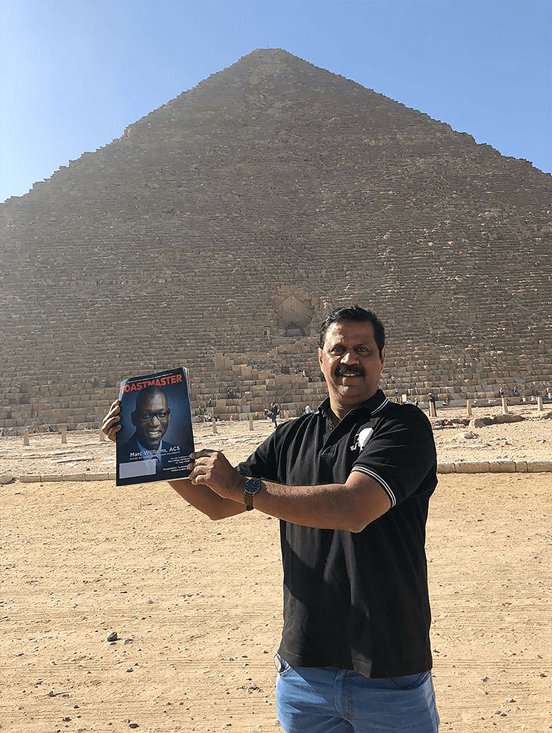 Kathiravan M. Pethi, DTM, of Bangalore, India, smiles in front of the Great Pyramid of Giza.