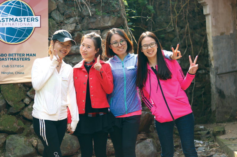 Members of Ningbo Better Man Toastmasters in Ningbo Zhejiang, China, express their enthusiasm for their club with warm smiles.