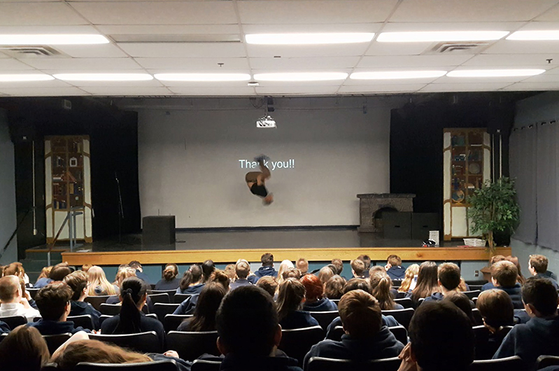 A former cheerleader and yoga instructor, Myles uses his talents to wow his audience of kids by performing a backflip onstage.