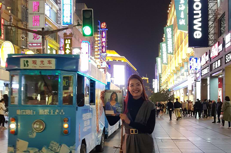 Donnabel Cantila, CC, CL, from Dubai, United Arab Emirates, poses in the busy streets of Shanghai, China, while on a work trip.