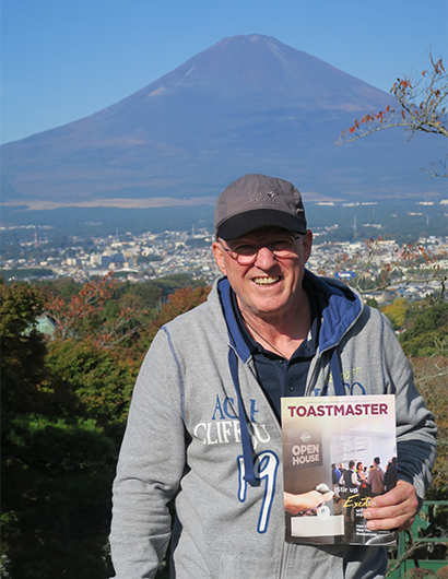 Edgar Niklaus, DTM, from Munich, Germany, poses while on vacation in Japan with Mount Fuji in the distance.