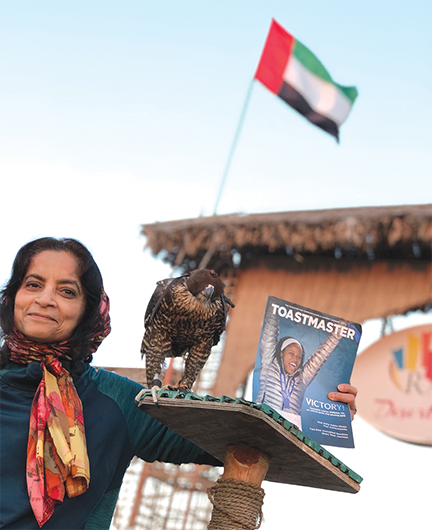 Farzana Chohan, DTM, a 2018–2019 region advisor from Chesterfield, Missouri, meets a peregrine falcon during a desert safari in Dubai, United Arab Emirates.