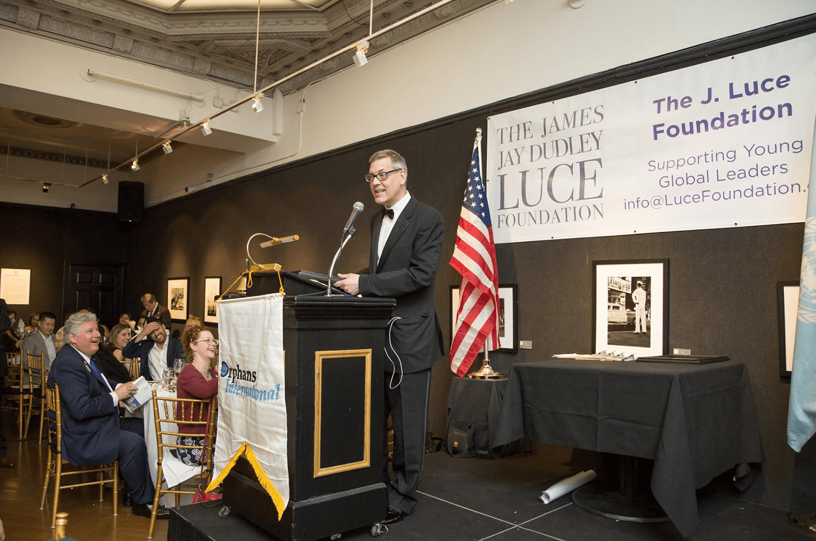 Jim Luce speaks to a crowd on behalf of the Jim Luce Foundation, supporting the Young Global Leaders program.