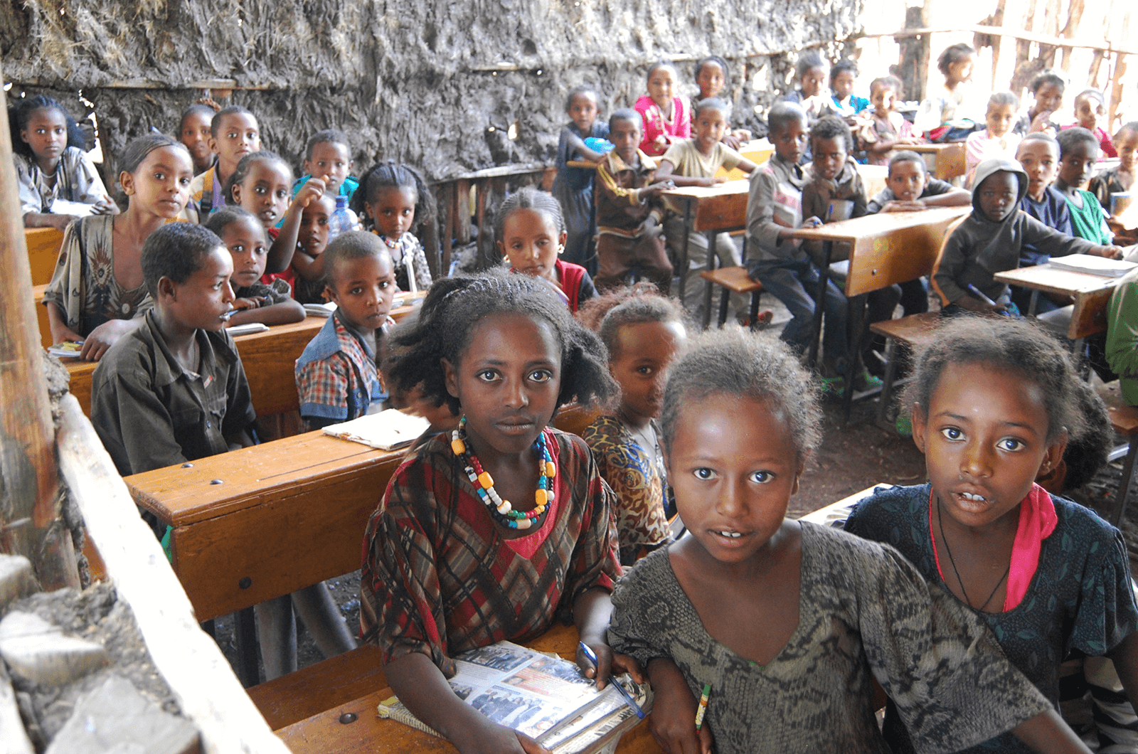 Children look at the camera at the rural school Toastmaster Lesley Stephenson and her team rebuilt in Mehoni, Ethiopia.