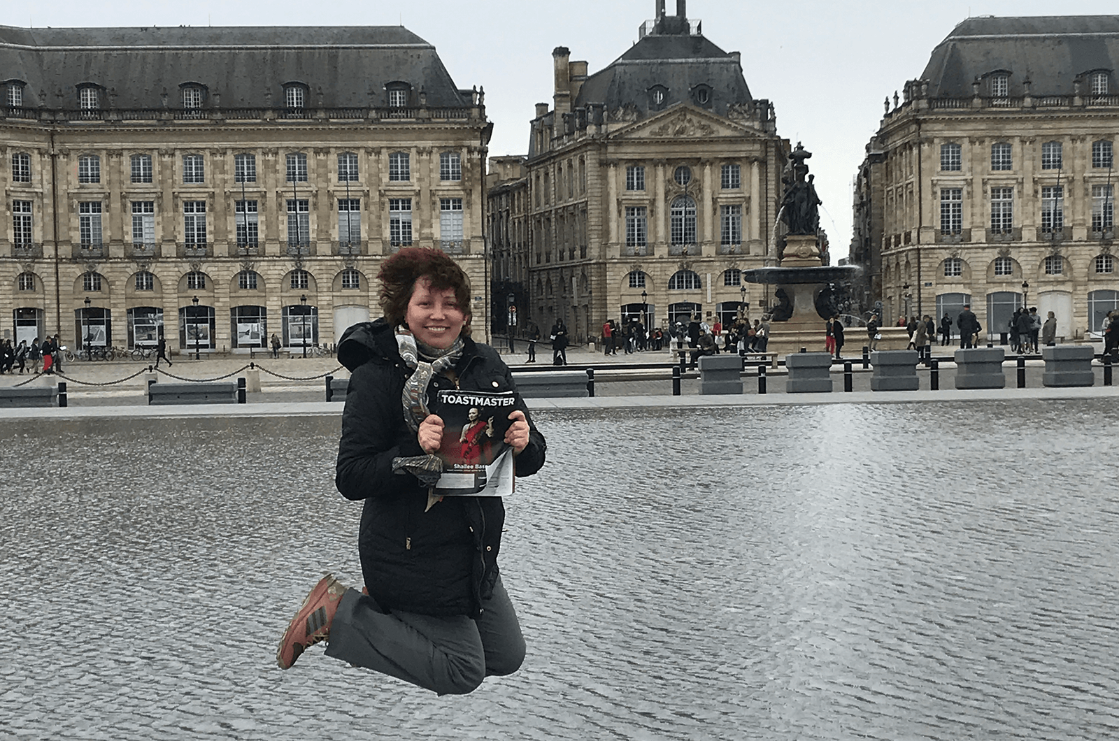 Elena Schwartz, of North Potomac, Maryland, jumps high in front of the Miroir d'eau (Water Mirror). The world's largest reflecting pool in Bordeaux, France, is just two centimeters deep.