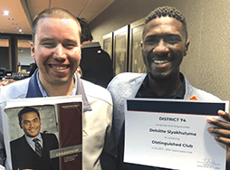 Garth Thomson and Matimu Marcus Manganyi hold Distinguished Club certificate