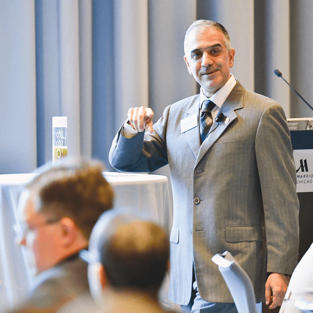 Past International President Mohammed Murad speaking at 2018 Convention