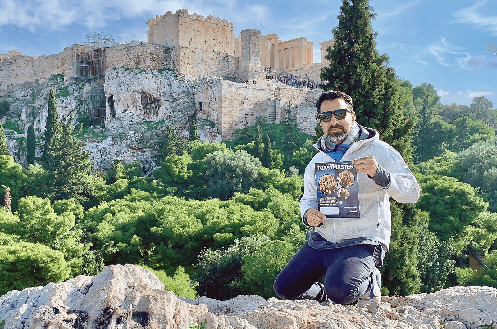 Amjad Ali of Dubai, United Arab Emirates, sits below the Acropolis of Athens, Greece, an ancient citadel perched above the city.